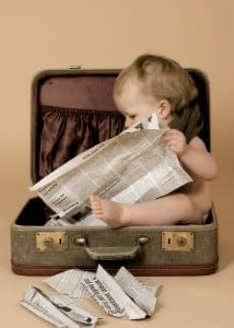 bigstock-Baby-Reading-The-Newspaper-414812