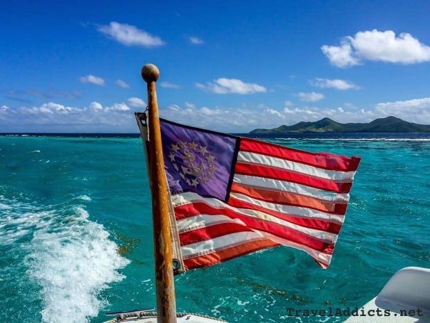 U.S. marine flag with Buck Island Reef National Monument, St. Croix, U.S. Virgin Islands in the background.