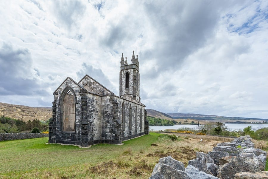 Traveling abroad can be prohibitively expensive but if you want to stretch your dollars and make the most of your vacation, check out these surprisingly affordable international spots including County Donegal in Ireland. This photo is of ruins of the Old Church of Dunlewey in County Donegal Ireland.