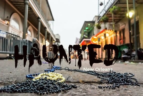 Discarded beads litter Bourbon Street in New Orleans early on a Sunday morning