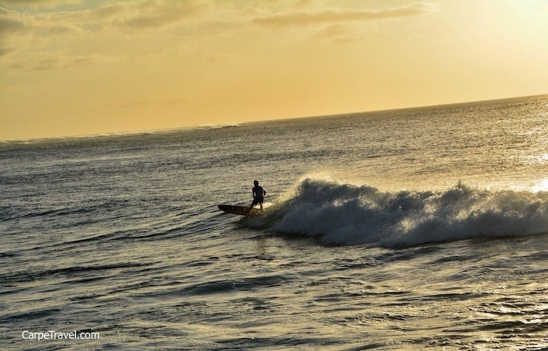 Sunsets along Oahu's fabled North Shore are filled with color...and surfers.
