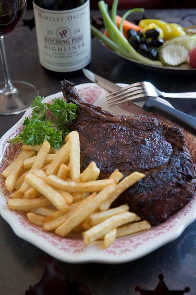Hitching Post II in Santa Ynez Valley shares its recipe and wine pairing for its Oak-Grilled Steak with Mushrooms, Onions and Pinot Noir Sauce